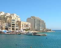 Photograph on the right of the Cavalieri Hotel, Spinola bay, St. Julian's Malta